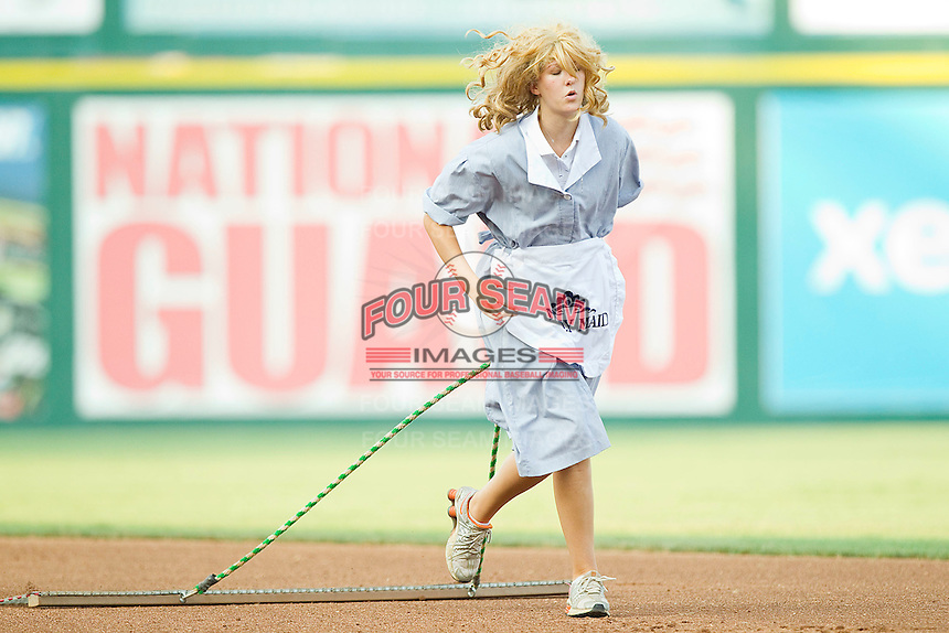 """A member of the Richmond Flying Squirrels grounds crew dresses as a """"Drag Queen"""" while dragging the infield between innings of the game against the Harrisburg Senators in game one of a double-header at The Diamond on July 22, 2011 in Richmond, Virginia.  The Squirrels defeated the Senators 3-1.   (Brian Westerholt / Four Seam Images)"""