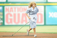 "A member of the Richmond Flying Squirrels grounds crew dresses as a ""Drag Queen"" while dragging the infield between innings of the game against the Harrisburg Senators in game one of a double-header at The Diamond on July 22, 2011 in Richmond, Virginia.  The Squirrels defeated the Senators 3-1.   (Brian Westerholt / Four Seam Images)"