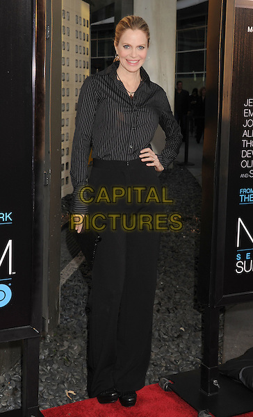"Kristin Bauer van Straten.HBO's ""The Newsroom"" Los Angeles Premiere held at The Cinerama Dome, Hollywood, California, USA..June 20th, 2012.full length hand on hip shirt trousers black pinstripe .CAP/ROT/TM.©Tony Michaels/Roth Stock/Capital Pictures"