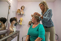 NWA Democrat-Gazette/ANTHONY REYES • @NWATONYR<br /> Rhonda Ceola, owner of With Grace Salon, takes a look at client Kathy Rinks hair Tuesday, Aug. 18, 2015 at With Grace Salon in Springdale. Ceola provides custom-made wigs, hair pieces and other services for women who struggle with hair loss.