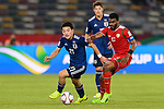 Doan Ritsu of Japan (L) competes for the ball with Ahmed Al Mahaijri of Oman during the AFC Asian Cup UAE 2019 Group F match between Oman (OMA) and Japan (JPN) at Zayed Sports City Stadium on 13 January 2019 in Abu Dhabi, United Arab Emirates. Photo by Marcio Rodrigo Machado / Power Sport Images