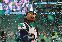 (02/04/2018- Minneapolis, MN) New England Patriots cornerback Stephon Gilmore walks off the field in a sea of green confetti after losing Super Bowl LII at US Bank Stadium on Sunday, February 4, 2018. Staff Photo by Matt West
