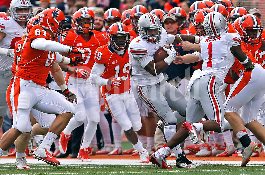 Ohio State Buckeyes running back Jordan Hall (7) fights off a crowd in the second quarter of their game against the Fighting Illini at Memorial Stadium in Champaign, Ill on November 16, 2013. (Columbus Dispatch photo by Brooke LaValley)