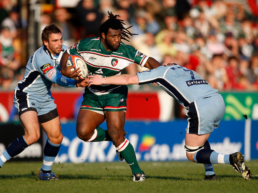 Photo: Richard Lane/Richard Lane Photography..Leicester Tigers v Cardiff Blues. EDF Energy Cup. 03/11/2007. .Tigers' Seru Rabeni is tackled by Blues' Nicky Robinson and Martyn Williams.