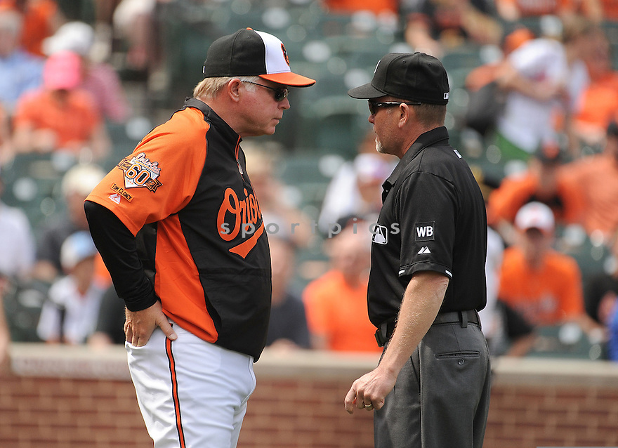 Baltimore Orioles Buck Showalter (26) during a game against the Toronto Blue Jays on April 13, 2014 at Oriole Park in Baltimore, MD. The Blue Jays beat the Orioles 11-3.