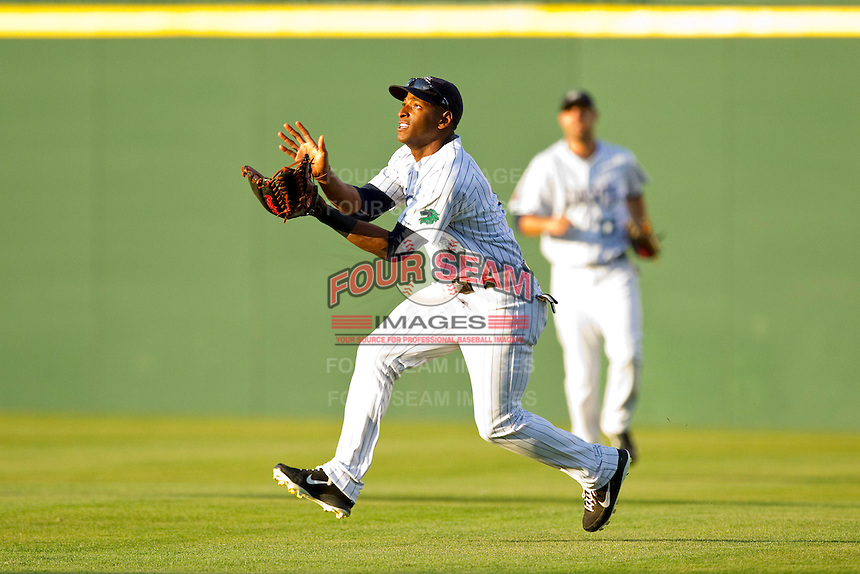 Charlotte Knights right fielder Greg Golson #2 makes a running catch against the Toledo Mud Hens at Knights Stadium on May 10, 2012 in Fort Mill, South Carolina.  (Brian Westerholt/Four Seam Images)