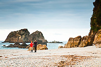 Women and boy on remote, wild West Coast beach - South Westland, West Coast, New Zealand