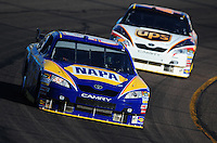 Apr 11, 2008; Avondale, AZ, USA; NASCAR Sprint Cup Series driver Michael Waltrip leads teammate David Reutimann during practice for the Subway Fresh Fit 500 at Phoenix International Raceway. Mandatory Credit: Mark J. Rebilas-