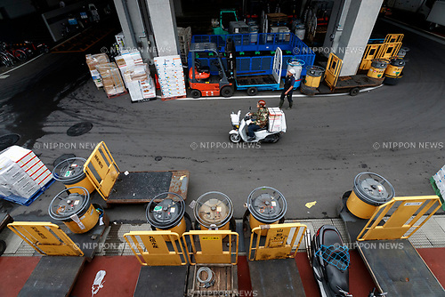 A worker transports merchandise at the new Tokyo Metropolitan Central Wholesale Market which opened in Toyosu on October 11, 2018, Tokyo, Japan. The new fish market replaces the famous Tsukiji Fish Market which closed for the last time on Saturday 6th October. The move to Toyosu was delayed for almost 2 years because of fears over toxins found in water below the new market. (Photo by Rodrigo Reyes Marin/AFLO)