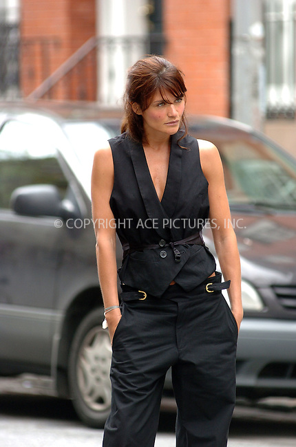 WWW.ACEPIXS.COM....April 24 2006, New York City....**EXCLUSIVE-FEE MUST BE AGRRED BEFORE USE**....Supermodel Helena Christensen poses up for a fashion shoot in the West Village.....Byline: ALICE STONE - ACEPIXS.COM....For information please contact:....212 243 8787 or 646 769 0430..Email: picturedesk@acepixs.com..Web: WWW.ACEPIXS.COM