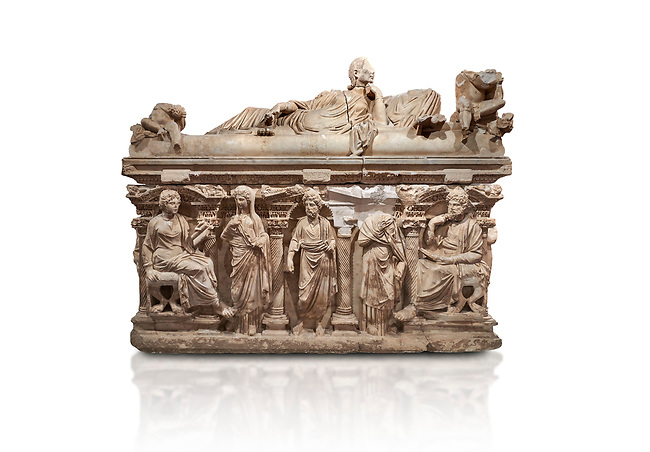 "Roman relief sculpted sarcophagus of Domitias Julianus and Domita Philiska depicted reclining on the lid, 2nd century AD, Perge. Antalya Archaeology Museum, Turkey.<br /> <br /> it is from the group of tombs classified as. ""Columned Sarcophagi of Asia Minor"". <br /> The lid of the sarcophagus is sculpted into the form of a ""Kline"" style Roman couch on which lie Julianus &  Philiska. This type of Sarcophagus is also known as a Sydemara Type of Tomb.. Against a white background."