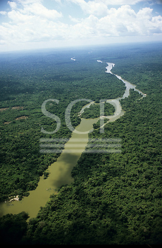 Bacaja village, Brazil. Aerial view of endless forest and sky with river, village and plots. Xicrin Indian tribe, Amazon.
