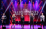 """Colin Cloud, Chloé Crawford, Shin Lim, Darcy Oake and Adam Trent from the cast of Broadway's """"The Illusionists—Magic of the Holidays"""" on stage for a press preview at the Marquis Theatre  on November 27, 2018 in New York City."""