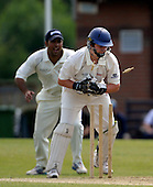 Scotland A versus MCC Select at New Cambusdoon, Ayr - Aberdeenshire's Matthew Cross removes the bailes to claim an MCC wicket, with former Clydesdale batsman Quasim Sheik waiting in the slips - Picture by Donald MacLeod 25.06.09