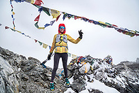 Kim Strom on Cho La Pass, after doing it in a snow storm, stands happy to have two of the three passes finished while trail running the 3 Passes Tour. Khumbu Valley, Nepal.