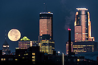 November 2016 super moon sets behind downtown Minneapolis.