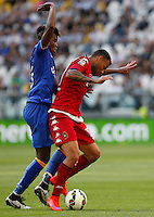 Calcio, Serie A: Juventus vs Cagliari. Torino, Juventus Stadium, 9 maggio 2015. <br /> Cagliari's Joao Pedro, right, is challenged by Juventus' Kingsley Coman during the Italian Serie A football match between Juventus and Cagliari at Turin's Juventus Stadium, 9 May 2015.<br /> UPDATE IMAGES PRESS/Isabella Bonotto