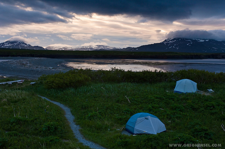 The Solstice casts a late night twilight over the tent sites at McNeil River Camp. Summer at McNeil River Bear Sanctuary in Southwest Alaska.
