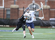 Washington, DC - April 7, 2018: Georgetown Hoyas Ryan Hursey (13) holds off a Providence Friars defender during game between Providence and Georgetown at  Cooper Field in Washington, DC.   (Photo by Elliott Brown/Media Images International)