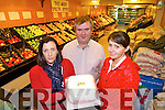 CAKES: Dan Horan, Listowel, with one of the Christmas cakes which are on sale, pictured here with Tess White and Siobha?n.Galvin.   Copyright Kerry's Eye 2008