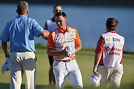 Gainesville, VA - August 2, 2015: Rickie Fowler completes his final round of regulation on the 18th hole of the Quicken Loans National at the Robert Trent Jones Golf Club in Gainesville, VA, August 2, 2015. He finished second in the tournament at 15-under. (Photo by Phillip Peters/Media Images International)