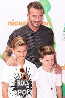 WESTWOOD, LOS ANGELES, CA, USA - JULY 17: Romeo Beckham, David Beckham, Cruz Beckham at the Nickelodeon Kids' Choice Sports Awards 2014 held at UCLA's Pauley Pavilion on July 17, 2014 in Westwood, Los Angeles, California, United States. (Photo by Xavier Collin/Celebrity Monitor)