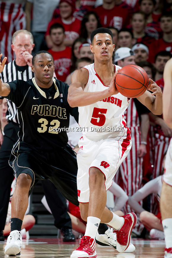 Wisconsin Badgers guard/forward Ryan Evans (5) passes the ball during a Big Ten Conference NCAA men's college basketball game against the Purdue Boilermakers on February 1, 2011 at the Kohl Center in Madison, Wisconsin. Wisconsin won 66-59. (Photo by David Stluka)