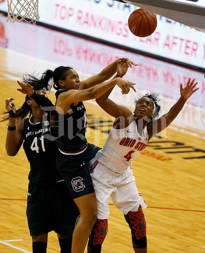 South Carolina Gamecocks guard Allisha Gray (10) blocks the shot of Ohio State Buckeyes guard/forward Sierra Calhoun (4) during the first half of the NCAA basketball game at Value City Arena in Columbus on Nov. 14, 2016. (Adam Cairns / The Columbus Dispatch)