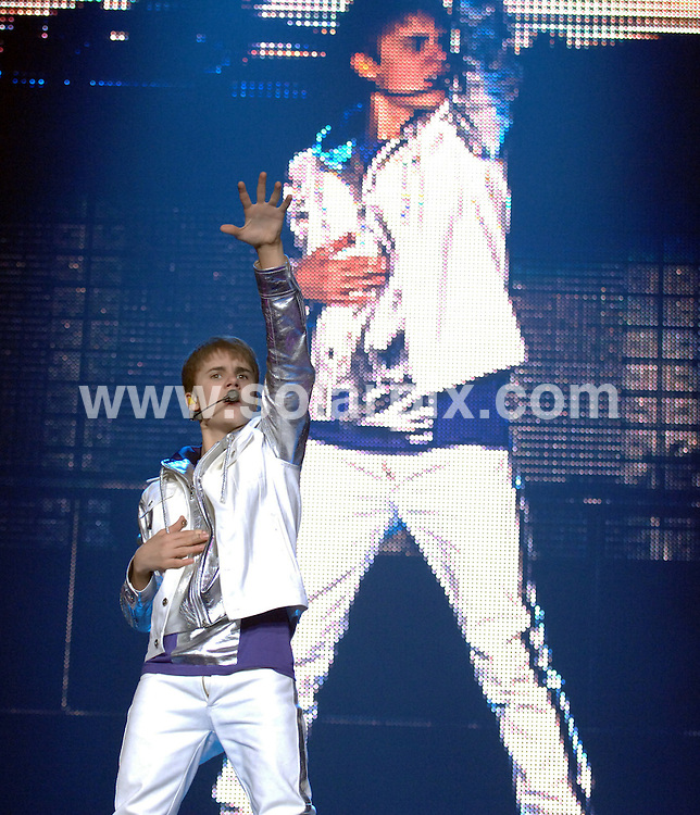 **ALL ROUND PICTURES FROM SOLARPIX.COM**                                             **WORLDWIDE SYNDICATION RIGHTS**                                                                                  Caption: American pop sensation Justin Bieber performs live in concert at the Liverpool Arena  in Liverpool UK                                                                                                                                                                          JOB REF: 12956       SGD       DATE: 11.03.2011                                                           **MUST CREDIT SOLARPIX.COM OR DOUBLE FEE WILL BE CHARGED**                                                                      **MUST AGREE FEE BEFORE ONLINE USAGE**                               **CALL US ON: +34 952 811 768 or LOW RATE FROM UK 0844 617 7637**