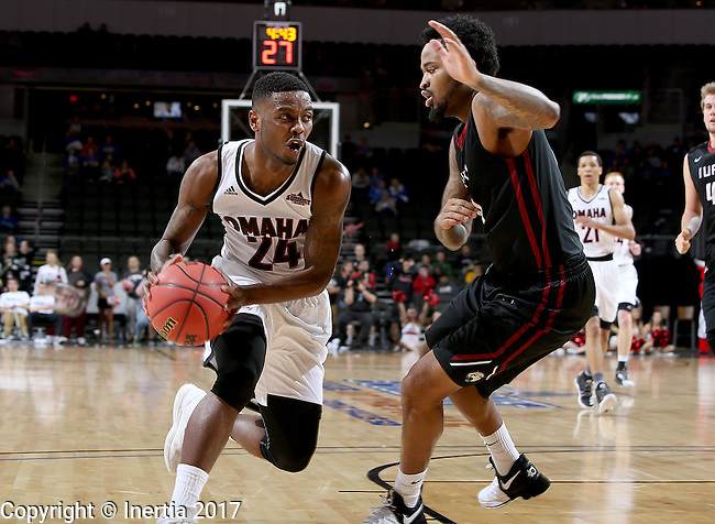 SIOUX FALLS, SD: MARCH 6: Tra-Deon Hollins #24 from Omaha looks to make a move past Darell Combs #0 from IUPUI during the Summit League Basketball Championship on March 6, 2017 at the Denny Sanford Premier Center in Sioux Falls, SD. (Photo by Dave Eggen/Inertia)