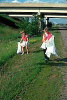 Girls age 16 picking up trash along the road.  St Joseph Minnesota USA