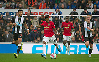 Fred of Man Utd between Joelinton (9) & Matty Longstaff of Newcastle United during the Premier League match between Newcastle United and Manchester United at St. James's Park, Newcastle, England on 6 October 2019. Photo by J GILL / PRiME Media Images.