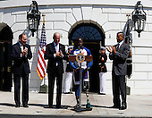 United States President Barack Obama (R), Vice President Joe Biden (2L), and Secretary of Veterans Affairs Robert McDonald (L)  applause Wounded Warrior Williams Reynolds (R) during the Wounded Warrior Ride event at the White House, in Washington, DC, April 14, 2016.  The event helps raise awareness to the public about severely injured veterans and provides rehabilitation opportunities. <br /> Credit: Aude Guerrucci / Pool via CNP