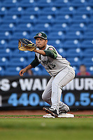 Fort Wayne TinCaps first baseman Fernando Perez (13) stretches for a throw during a game against the Lake County Captains on August 21, 2014 at Classic Park in Eastlake, Ohio.  Lake County defeated Fort Wayne 7-8.  (Mike Janes/Four Seam Images)
