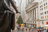 The George Washington statue in front of Federal Hall and the New York Stock Exchange on Wednesday, November 30, 2016 with their Christmas tree and the facade decorated with wreaths.  (© Richard B. Levine)