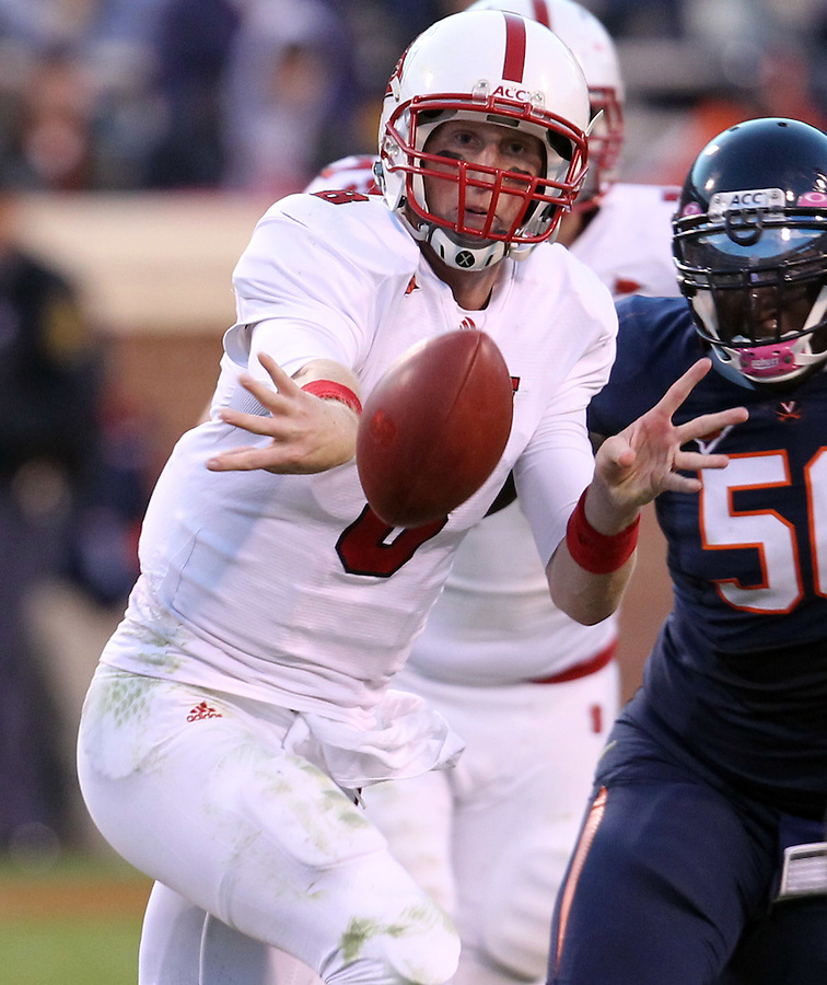 Oct. 22, 2011 - Charlottesville, Virginia - USA; North Carolina State quarterback Mike Glennon (8) handles the ball during an NCAA football game against the Virginia Cavaliers at the Scott Stadium. NC State defeated Virginia 28-14. (Credit Image: © Andrew Shurtleff
