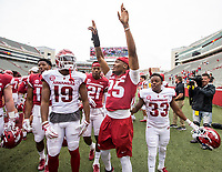 Hawgs Illustrated/BEN GOFF <br /> Players celebrate Saturday, April 6, 2019, after the Arkansas Red-White game at Reynolds Razorback Stadium.