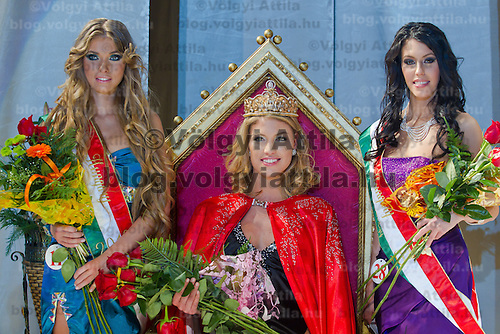 Ivett Venczlik (left) placed second, Dora Gregori (center) winner of the contest and Zsofia Botos (right) placed third celebrate their victory during the Miss Hungary 2010 beauty contest held in Budapest, Hungary on November 29, 2010. ATTILA VOLGYI