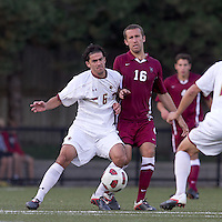 Boston College midfielder Steve Rose (6) and Harvard University defender Tim Linden (16) battle for the ball. Boston College defeated Harvard University, 2-0, at Newton Campus Field, October 11, 2011.