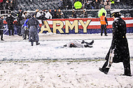 PHILADELPHIA, PA - DEC 9, 2017: A Army fan makes a snow angel in the snow following an Army victory over Navy at Lincoln Financial Field Philadelphia, PA. Army defeated Navy 14-13 to win the Commander in Chief Cup. (Photo by Phil Peters/Media Images International)