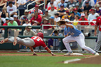 North Carolina first baseman Cody Stubbs (25) makes a catch during a pickoff attempt at first base during Game 3 of the 2013 Men's College World Series against the North Carolina State Wolfpack at TD Ameritrade Park on June 16, 2013 in Omaha, Nebraska. The Wolfpack defeated the Tar Heels 8-1. (Andrew Woolley/Four Seam Images)