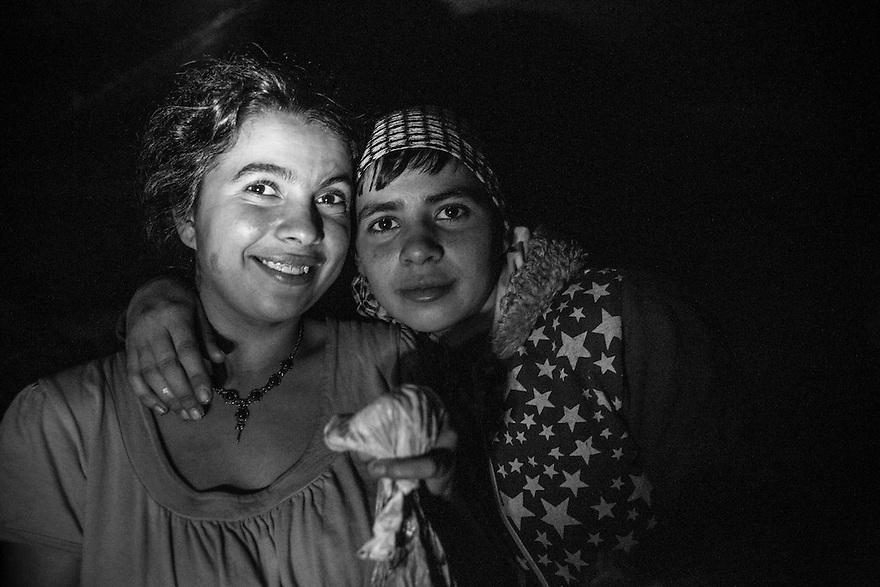 Carina, left, and Cristina underground. Thousands of minors and young adults live in Bucharest's vast system of underground canals used for heating, water and sewage pipes. Many were raised in Romania's vast orphanage system. Addiction, especially to huffing metallic paint, heroine and other injected drugs is widespread.