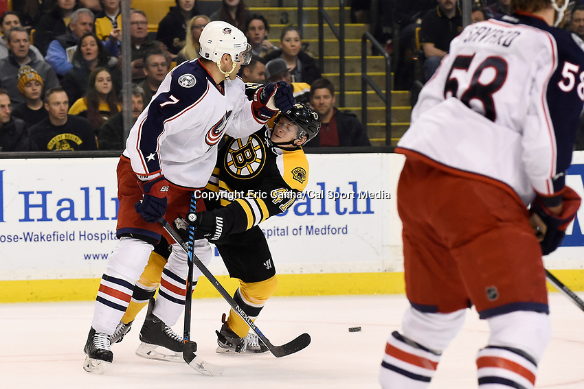 Monday, February 22, 2016:  Columbus Blue Jackets defenseman Jack Johnson (7) and Boston Bruins defenseman Torey Krug (47) battle on the ice during the National Hockey League game between the Columbus Blue Jackets and the Boston Bruins, held at TD Garden, in Boston, Massachusetts. The Blue Jackets defeat the Bruins 6-4. Eric Canha/CSM<br /> <br /> *** Headline correction *** This corrects an earlier version that headlined the game as Blues vs Bruins FEB 22.