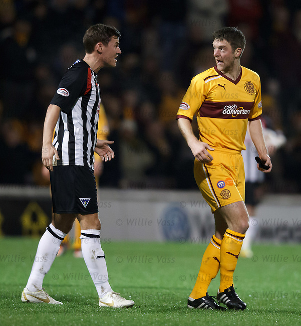 Stephen Craigan and Andy Barrowman exchange angry words after the Motherwell captain's red card