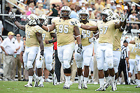 September 28, 2013 - Orlando, FL, U.S: UCF Knights linebacker Terrance Plummer (41), UCF Knights defensive lineman E.J. Dunston (95) and UCF Knights linebacker Troy Gray (57) get the student section fired up during 1st half NCAA football game action between the South Carolina Gamecocks and the UCF Knights at Bright House Networks Stadium in Orlando, Fl