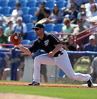 Toronto Blue Jays Adam Lind #26 during a Spring Training game vs the Detroit Tigers at Florida Auto Exchange Stadium in Dunedin, Florida;  February 26, 2011.  Detroit defeated Toronto 4-0.  Photo By Mike Janes/Four Seam Images