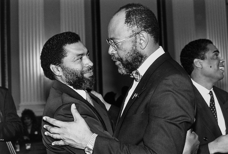 Rep. Craig Washington, D-Tex., being congratulated by Gaston Leland, brother of late Rep. Mickey Leland after swear-in, on Jan. 23, 1990. (Photo by Maureen Keating/CQ Roll Call)