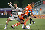 14 April 2012: Carolina's Amir Lowery (right) and Atlanta's Tony McManus (30). The Carolina RailHawks played the Atlanta Silverbacks to a 4-4 tie at WakeMed Soccer Stadium in Cary, NC in a 2012 North American Soccer League (NASL) regular season game.