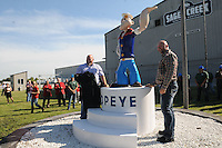 NWA Democrat-Gazette/FLIP PUTTHOFF <br /> SPINACH AND MORE<br /> David Wilks (left) and Dwayne Queen unveil a new statue of Popeye the Sailor during ceremonies Friday Sept. 18 2015 to mark the opening of the Springdale location of Sager Creek Vegetable Company. The facility, formerly Allen Canning Co., has been closed for some time but is now operating under the Sager Creek name. The company headquarters are in Siloam Springs. Del Monte Foods owns Sager Creek Vegetable Company and has opted to keep the original name, said Mike Zelkind, company president.