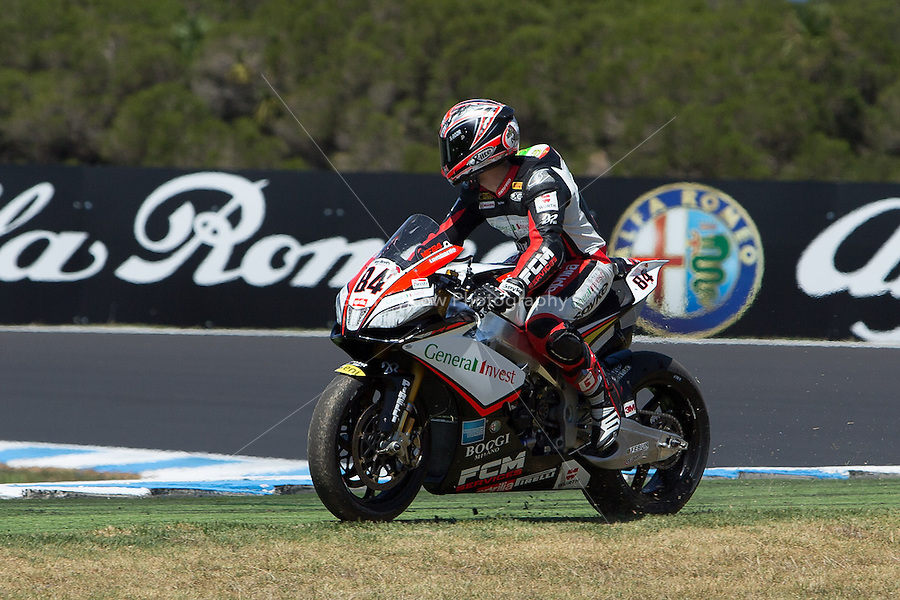 Michel Fabrizio (ITA) riding the Aprilia RSV4 1000 Factory (84) of the Red Devils Roma team misses the entry to turn 10 during a practise session on day two of round one of the 2013 FIM World Superbike Championship at Phillip Island, Australia. rounds turn 11 during a practise session on day two of round one of the 2013 FIM World Superbike Championship at Phillip Island, Australia.